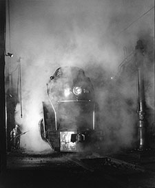 Washing a Steam Train at the Station