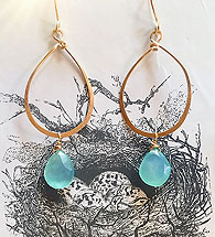 Gold earrings with blue stones, by Cara Wolff