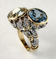 Leafy bypass ring with aquamarine and diamond