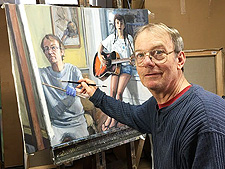 Ralph DeAnna painting in the studio