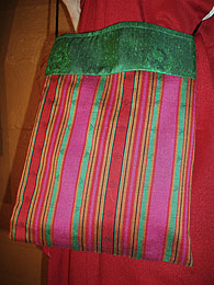 Striped bag with green top edge