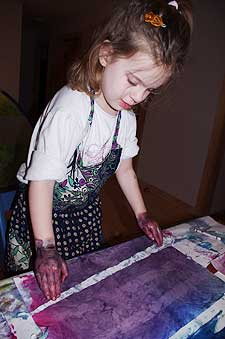 A young child making art